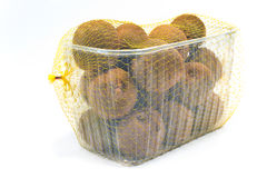 Kiwi fruit in plastic bowl stock image