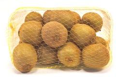 Kiwi fruit in plastic bowl isolated on white Stock Photo