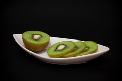 Kiwi fruit on a plate Royalty Free Stock Photography