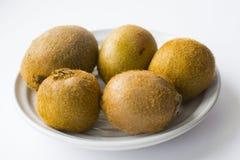 Kiwi fruit on plate Stock Photos