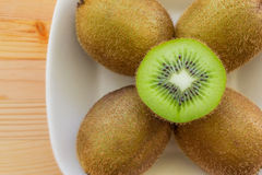 Kiwi fruit on a plate Stock Photo