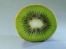 Kiwi fruit. Ripe kiwi on blue wooden table close-up Royalty Free Stock Photography