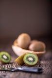 Kiwi Fruit. Several kiwi fruit on oak wooden surface Stock Photo