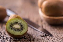 Kiwi Fruit. Several kiwi fruit on oak wooden surface Stock Image