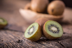 Kiwi Fruit. Several kiwi fruit on oak wooden surface Royalty Free Stock Image