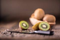 Kiwi Fruit. Several kiwi fruit on oak wooden surface Stock Photography