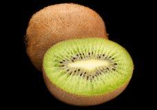 Kiwi fruit slice on black background Stock Image