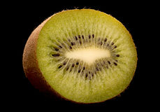 Kiwi fruit slice on black background Stock Image