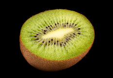 Kiwi fruit slice on black background Royalty Free Stock Photos