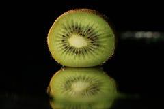 Kiwi fruit slice on black water Stock Image