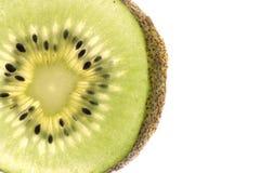 Kiwi fruit slice close up on white Royalty Free Stock Images