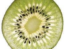 Kiwi fruit slice close up on white Royalty Free Stock Photo