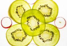 Kiwi fruit slice on a light background Stock Photography