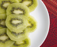 Kiwi Fruit Slice on White dish Royalty Free Stock Photos