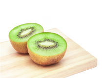 Kiwi fruit slice on wooden chopping board in white background Stock Photo