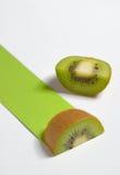 Kiwi fruit sliced and green path Stock Photo
