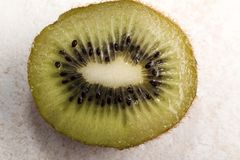 Kiwi Fruit Sliced In Half On Tile Cutting Board royalty free stock images