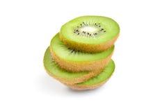 Kiwi fruit sliced segments on white background. Royalty Free Stock Image