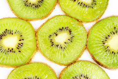 Kiwi fruit sliced on a white Stock Photography