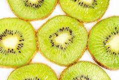 Kiwi fruit sliced on a white Stock Photography