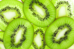 Kiwi fruit slices. (chinese gooseberry) one above the other Stock Photos
