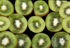 Kiwi fruit slices. Background Stock Image