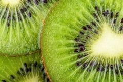 Kiwi fruit slices background Stock Photos