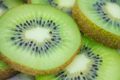 Kiwi fruit slices background Royalty Free Stock Photography