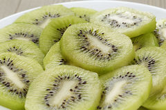 Kiwi fruit slices background Stock Photography