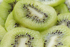 Kiwi fruit slices background Stock Photos