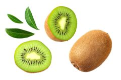 Kiwi fruit with slices and green leaves isolated on a white background stock photo