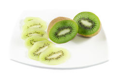 Kiwi fruit and slices over white isolated background. Piece of kiwi fruit and slices over white isolated background Royalty Free Stock Photos