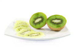 Kiwi fruit and slices over white isolated background. Piece of kiwi fruit and slices over white isolated background Royalty Free Stock Image