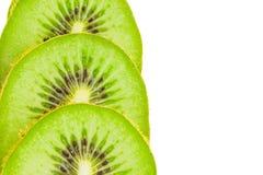 Kiwi fruit slices. Three kiwi fruit slices isolated on white background Stock Photo