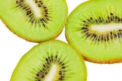Kiwi fruit slices. Three kiwi fruit slices isolated on white background Royalty Free Stock Photo