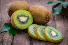 Kiwi fruit slices on wooden table Stock Images