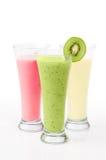 Kiwi & Fruit Smoothies. Three fruit smoothies in tall glasses on white background royalty free stock photo
