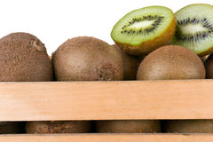 Kiwi fruit and some cut ones in a wooden box. Crate Royalty Free Stock Photos