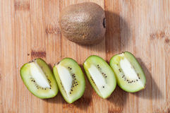 Kiwi fruit. Some slices of kiwi fruit  on chopping board Royalty Free Stock Photos