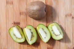 Kiwi fruit. Some slices of kiwi fruit on chopping board royalty free stock photos