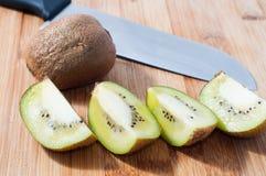 Kiwi fruit. Some slices of kiwi fruit  on chopping board stock photography