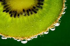 Kiwi fruit in sparkling water Royalty Free Stock Photo