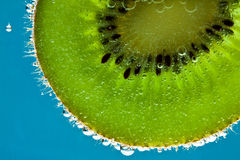 Kiwi fruit in sparkling water Royalty Free Stock Photos