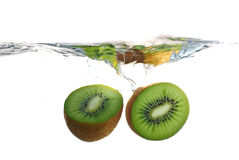 Kiwi fruit splashing into water Royalty Free Stock Image
