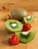 Kiwi fruit and strawberries Stock Image