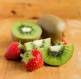 Kiwi fruit and strawberries Royalty Free Stock Photos