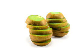 Kiwi Fruit Towers. Two sliced kiwi fruit standing in towers Royalty Free Stock Photos