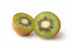 Kiwi fruit on white background. Two halves of a ripe juicy kiwi fruit on white background Stock Photos