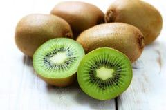 Kiwi fruit on white wooden. Background Royalty Free Stock Photo