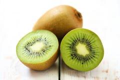 Kiwi fruit on white wooden Royalty Free Stock Photo